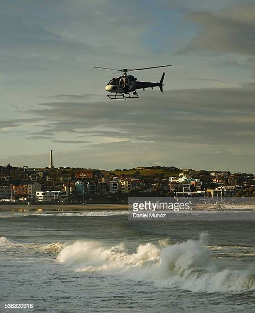 A police helicopter search for a missing person at Bondi beach on June 6 2016 in Sydney Australia Torrential rain over the weekend saw streets and...