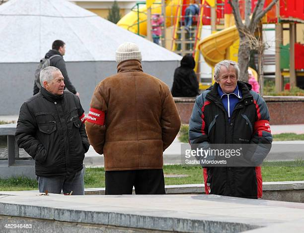 Police helpers are seen near the entrance of the State Council in Simferopol on April 5 2014 in Simferopol in the disputed Crimean Peninsula Many...