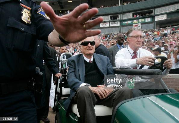 A police helps to clear a path for Billy Graham to pass through as he arrives to give the final message of the Metro Maryland 2006 Festival July 9...