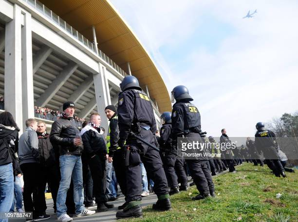 Police hold back fans prior to the Bundesliga match between Eintracht Frankfurt and 1FC Kaiserslautern at Commerzbank Arena on March 5 2011 in...