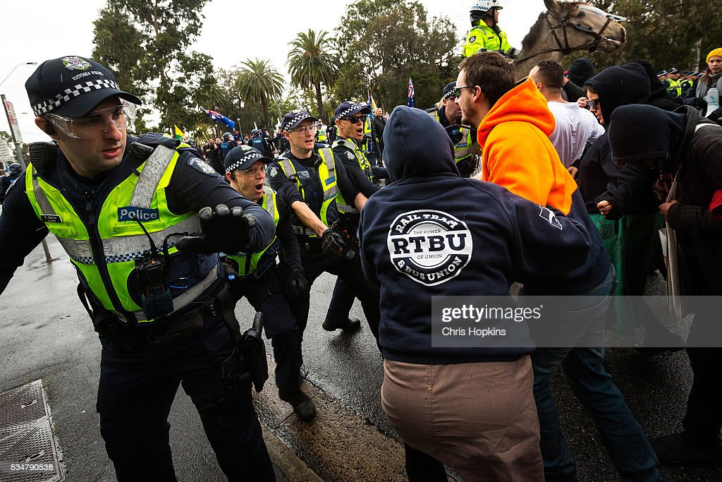 Police hold back left leaning members of teh 'Say no to Racisim' group on May 28, 2016 in Melbourne, Australia. Violence erupted when participants in a 'Say No To Racism' rally protesting the forced closure of Aboriginal communities, off-shore detention centres and Islamophobia met with a counter 'Anti-Islam rally organised by the True Blue Crew and backed by the United Patriots Front.