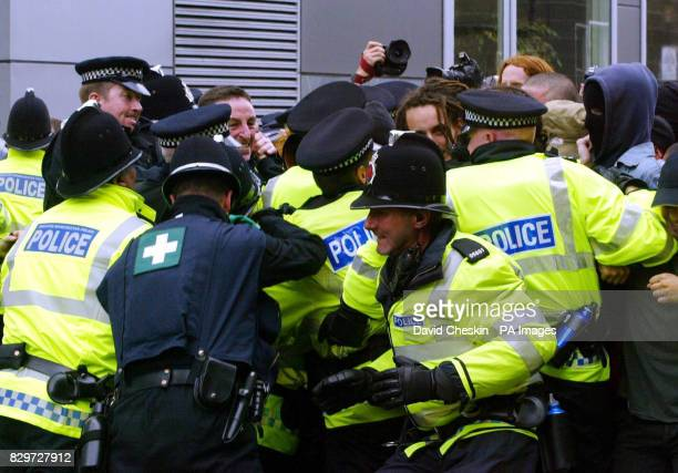 Police hold back protesters in the financial centre of Edinburgh as anticapitalist demonstrators took to the streets of Scotland's capital ahead of...