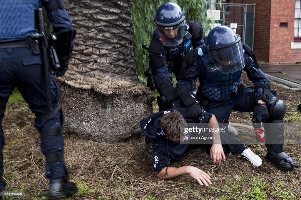 Police hold down a member of the True Blue Crew after pepper spray was used to break a fight during a 'Say No To Racism' protest and a counter 'Stop the Far Left' rally in Coburg Melbourne, Australia on May 28, 2016. Seven men were arrested after a violent brawl erupted between rival protesters at an anti-racism rally in Melbourne's inner-north. Anti-Facists clashed with Anti-Islam nationalists who go by the name 'True Blue Crew'.
