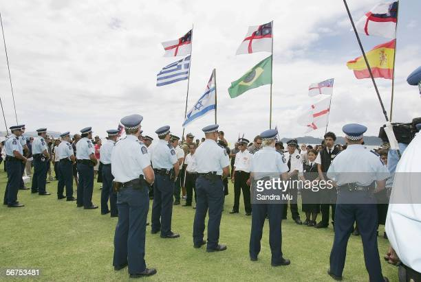 Police hold their ground to protect the flag pole as protesters make their way across the Treaty grounds during the Waitangi Day celebrations...