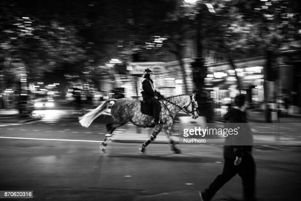 A Police horse is running to contain the crowd in Trafalgar Square during the anticapitalist 'Million Masks March' organised by the group Anonymous...