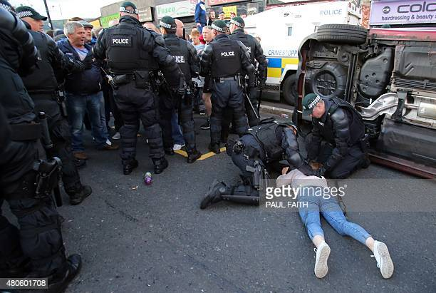Police in Ardoyne attend to an injured girl after rolling the car off her which had driven into a crowd of people outside Ardoyne shops in north...