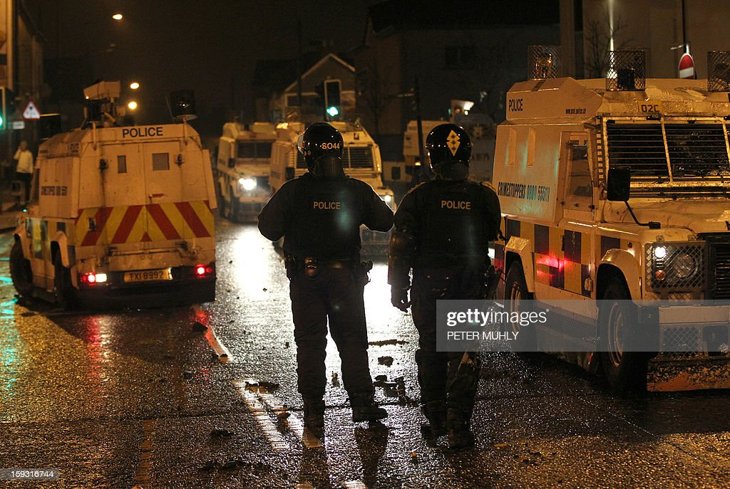 Police in armoured vehicles secure the area in Carrickfergus, near Belfast in County Antrim, Northern Ireland on January 11, 2013 after a Loyalist demostration as part of an ongoing campaign opposing Belfast City Council's decision to restrict the days on which the British Union Flag will fly over the City Hall. Pro-British demonstrators have taken to the streets, in sometimes violent protest, almost every night since December 3, when the city council announced it would no longer fly the Union Flag all year round at City Hall. Protesters have pelted police with petrol bombs, fireworks, bottles and stones.