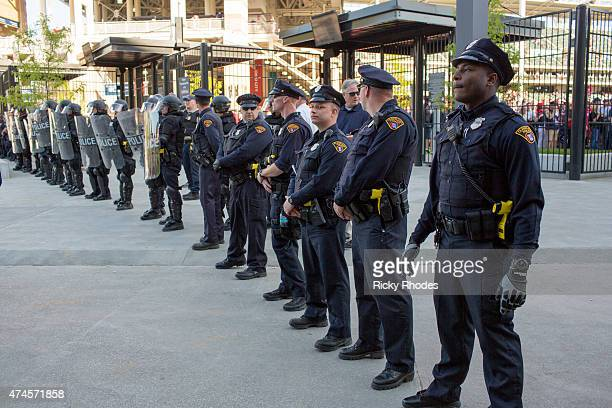 Police in front of Progressive Field stand guard during demenstrations in reaction to Cleveland police officer Michael Brelo being acquitted of...