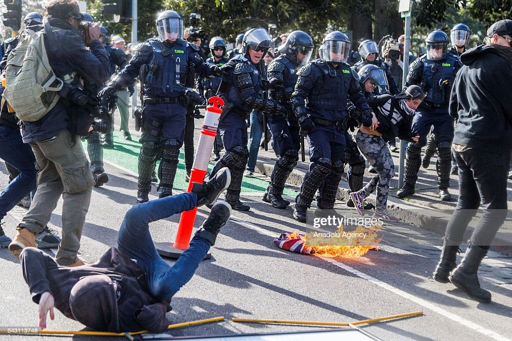 Police in riot gear charge at anti fascists after they burnt the Australian Flag during a protest organized by the anti-Islam True Blue Crew supported by the United Patriots Front in Melbourne, Australia on June 26, 2016.