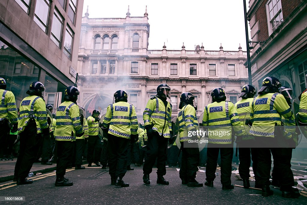 CONTENT] Police in riot gear face protesters on Piccadilly W1 shortly before the occupation of Fortnum and Mason' during a demonstration Against the Conservative Led Coalition Government by UK wide group largely organised by the Trade Union Congress (TUC) who referred to their protest as the March for the Alternative.