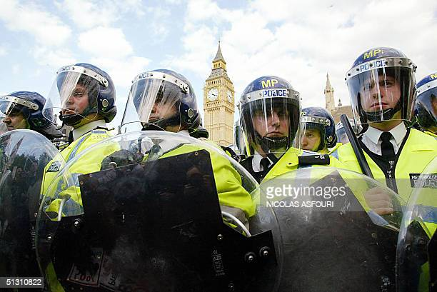 Police in riot gear form a line around the Parliament to prevent protesters to enter during a prohunting demonstration in London 15 September 2004...