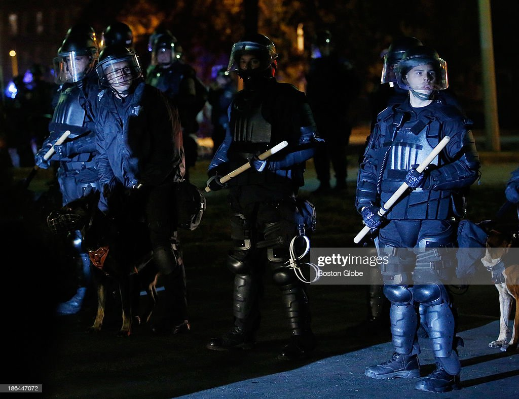Police in riot gear move people back after celebrations outside of Fenway Park got out of control after the Red Sox won Game Six and the World Series at Fenway Park in Boston, Oct. 31, 2013.