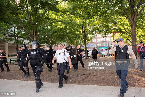 Police in riot gear run towards Progressive Field to hold off protesters People take to the streets and protest in reaction to Cleveland police...