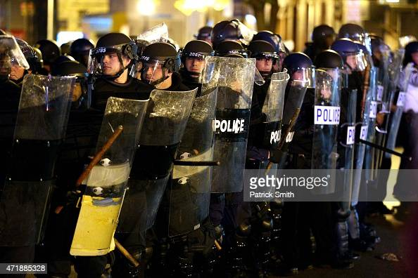 Police in riot gear stand on North Avenue after Baltimore authorities released a report on the death of Freddie Gray on May 1 2015 in Baltimore...