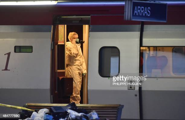 Police inspect a crime scene inside a Thalys train of French national railway operator SNCF at the main train station in Arras northern France on...