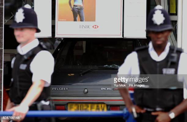 Police inspect outside the HSBC bank in Southgate north London after an armed robbery which took place today A sixty year old man was injured during...