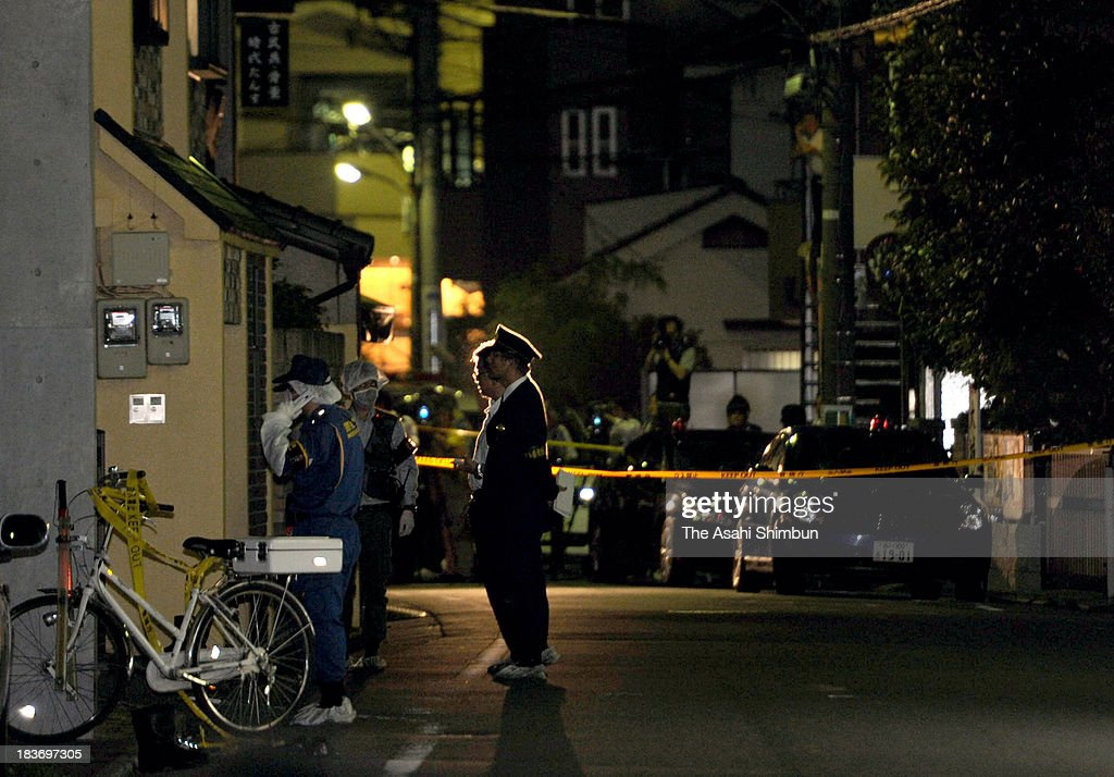 Police inspect the area around where Saya Suzuki was stabbed on October 8, 2013 in Tokyo, Japan. An 18-year-old high school student was stabbed to death in a residential district of Tokyo, hours after she and her parents told police that she was being stalked and threatened by her former boyfriend. Police arrested Charles Thomas Ikenaga, 21, on suspicion of attempted murder. He admitted to stabbing Suzuki with a knife, and said he harbored a grudge after they separated.