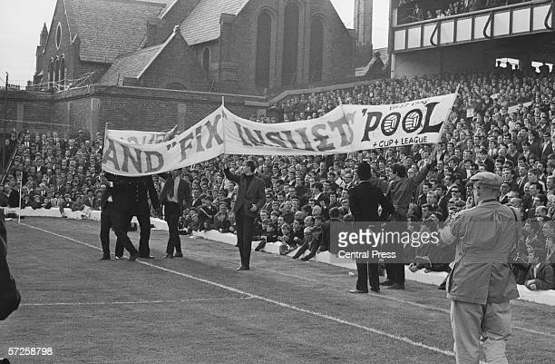 Police intervene as fans with a large banner protest against an England fix at the semi final between Russia and West Germany at Goodison Park during...