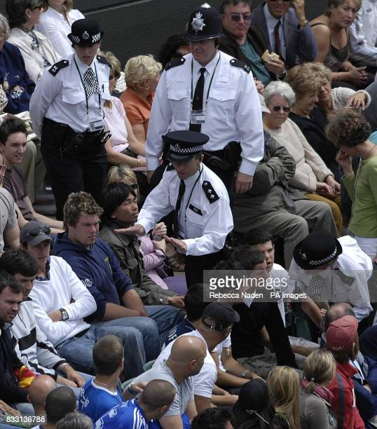 Police intervene during crowd disturbance on Court One during the men's singles match between Serbia's Novak Djokovic and Cyprus' Marcos Baghdatis...