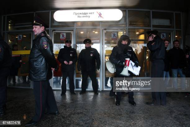 Police intervene in a rally that urging Vladimir Putin not to run for a fourth term for Presidential elections at Gorkovskaya subway station in...