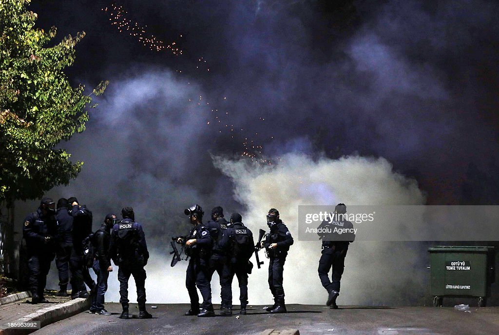 Police intervened the group of students with using tear gas on October 26, 2013 in Ankara. A group of students gather at the A-4 entrance of Ankara's Middle East Technical University (METU), to protest against the road construction which is planned to construct a new road through METU campus area.