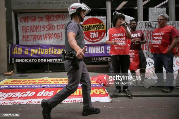 Police intervenes in a demonstration against employee layoffs and the expansion of the privatization of subway lines in front of the subway...