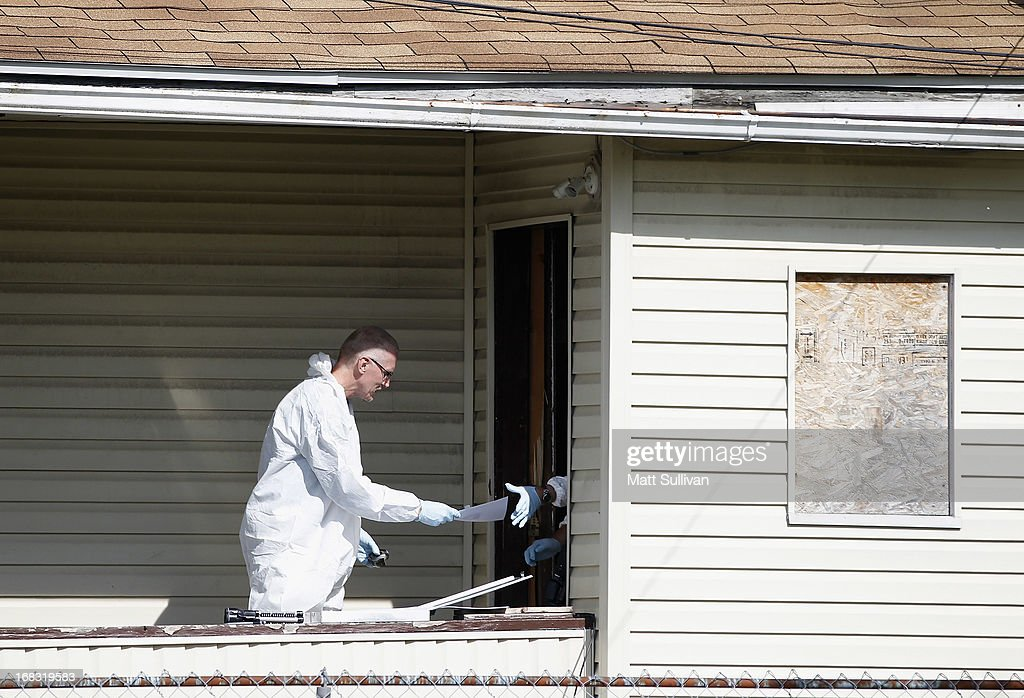 Police investigate a home down the street from the house where three women were held captive for a decade, May 8, 2013 in Cleveland, Ohio. Amanda Berry, Gina DeJesus, and Michelle Knight managed to escape their captors on May 6, 2013. Ariel Castro was charged with kidnap and rape. His brother Pedro and Onil Castro, were taken into custody but not charged.