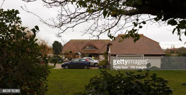 Police investigate a house in Smuggler's Lane Bosham West Sussex where a 55 year old woman was found murdered