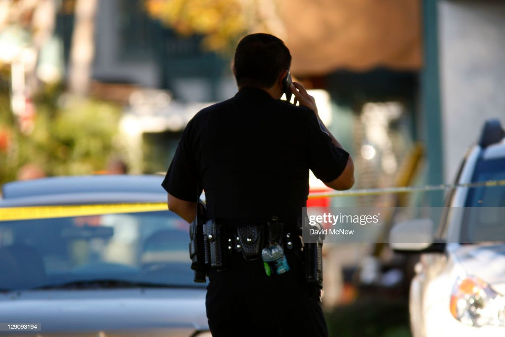 Police investigate a murder scene at Salon Meritage hair salon after a man shot nine people killing eight of them on October 12 2011 in Seal Beach...