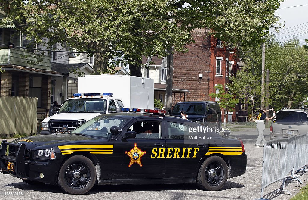 Police investigate houses down the street from the house where three women were held captive for close to a decade May 8 2013 in Cleveland Ohio...