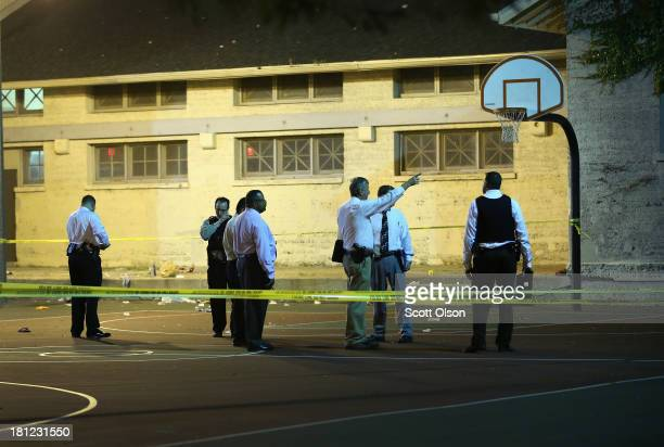 Police investigate the scene in Cornell Square Park on the Southside where 11 people including a threeyearold child were shot on September 19 2013 in...