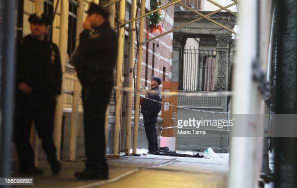 Police investigate the scene of a fatal shooting at 202 West 58th Street in Manhattan on December 10 2012 in New York City The victim identified as a...