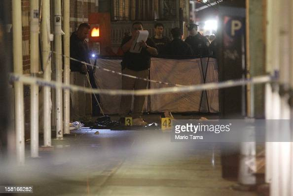 Police investigate the scene of a fatal shooting on W 58th Street in Manhattan on December 10 2012 in New York City A 31yearold man was shot in the...