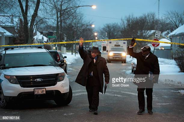Police investigate the scene of a quadruple homicide on the city's Southside on December 17 2016 in Chicago Illinois Three people were found shot to...