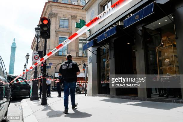 Police investigate the scene of a robbery at the Italian jewelry company Buccellati on rue de la Paix in Paris on May 23 2017 A jewelry store located...