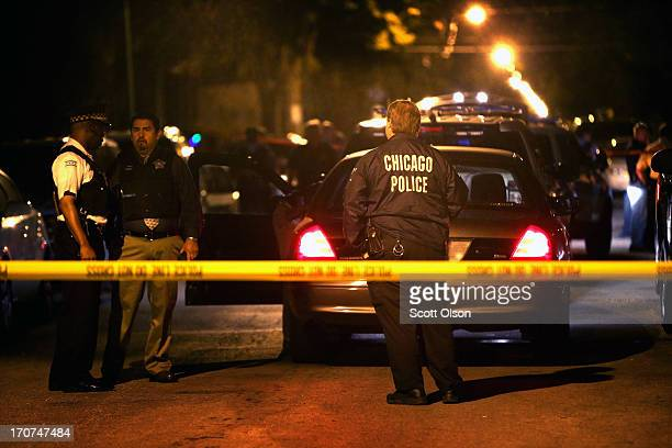 Police investigate the scene where a 15yearold boy was shot and killed by police after he reportedly pointed a gun at officers during a foot chase on...