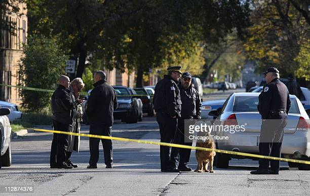 Police investigate the scene where a child's body was found in a 1994 white Chevrolet Suburban Monday October 27 in Chicago Illinois Authorities...