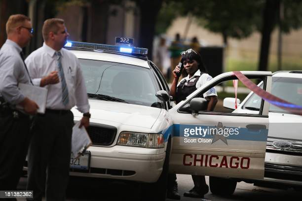 Police investigate the shooting death of 14yearold Tommy McNeal on September 20 2013 in Chicago Illinois McNeal was one of at least 3 killed and...