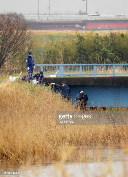 Police investigate the site where a body was discovered near a gutter in farmland in the city of Abiko northeast of Tokyo in Chiba prefecture on...