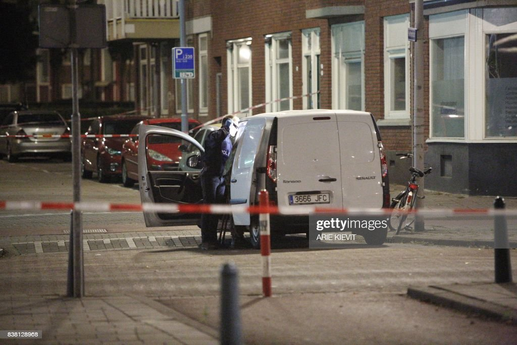 TOPSHOT - Police investigates a van with Spanish number plate packed with gas canisters in the vicinity of the concert venue Maassilo, after a concert was cancelled because of a terror threat, in Rotterdam, on August 23, 2017. A rock concert in Rotterdam was cancelled on August 23 due to a terror threat involving a Spanish van found with gas bottles inside, the local mayor said. Earlier the Maassilo venue announced that 'due to a terrorist threat, the Allah-Las concert will not take place this evening, on police orders'. Rotterdam police confirmed the decision was taken due to a 'possible terrorist threat' and that the van's driver had been arrested. / AFP PHOTO / ANP / Arie Kievit / Netherlands OUT