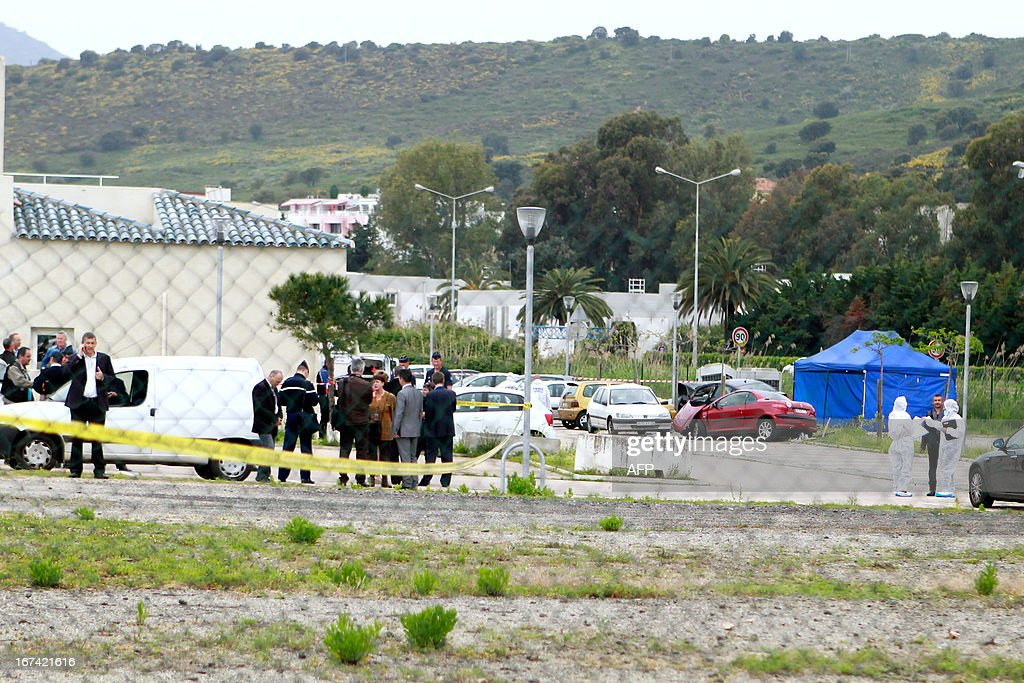 Police investigators and forensic experts work on April 25, 2013 at the site where the president of the Corsica Regional National Parc (PNRC), Jean-Luc Chiappini, 65, was shot dead returning from the Napoléon-Bonaparte airport in Campo dell'Oro, outside the southwestern city of Ajaccio on the French Mediterranean island of Corsica. It is the 10th homicide perpetrated in Corsica, an island of 310,000 inhabitants, in 2013. CASABIANCA