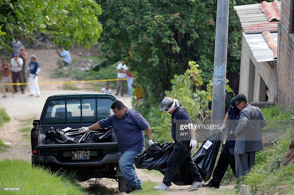 Police investigators carry one of the bodies of two women and two teenagers Marisol Elizabeth Argueta Keny Sarahí Argueta Fatima Gonzalez Escobar 20...
