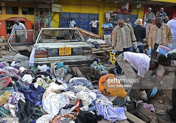 Police investigators comb through the scene of an explosion on May 16 2014 on the outskirts of Nairobi's business district where twin explosions...