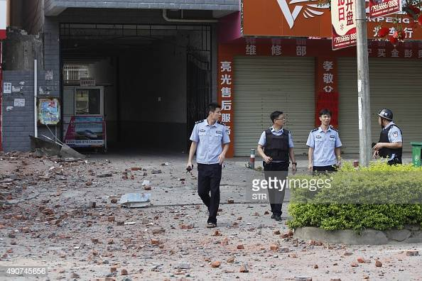 Police investigators inspect the area after a blast occurred in the early morning in Liucheng a rural county of the Guangxi region on October 1 one...