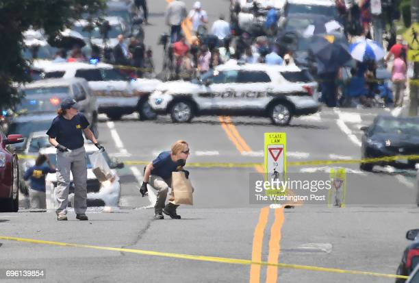 Police investigators work the scene along E Monroe Ave near Eugene Simpson Stadium Park after reports of shots fired on Wednesday June 14 2017 in...