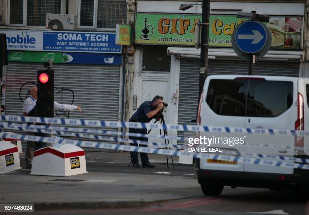 Police investigators work the scene in the Finsbury Park area of north London after a vehichle hit pedestrians on June 19 2017 One man was killed and...