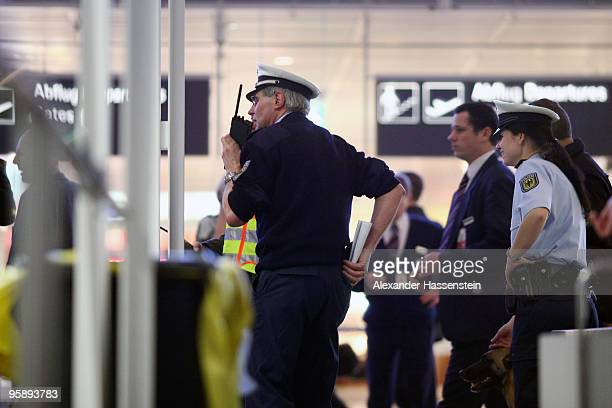 Police is busy at the Munich airport on January 20 2010 in Munich Germany A man broke through the security check and disappeared into the secure area...
