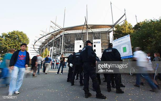 Police is seen at the Arena prior to the start of the Bundesliga match between Hamburger SV and FC Schalke 04 at Imtech Arena on October 2 2011 in...