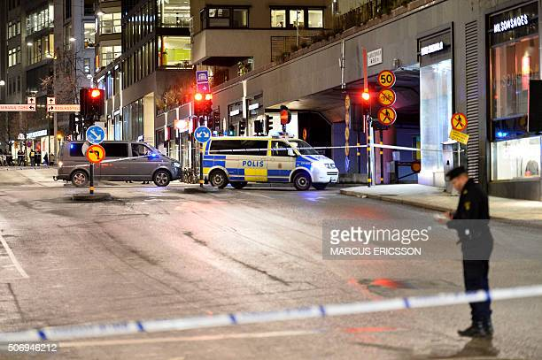 Police is seen near the shopping mall 'Moodgallerian' and a car tunnel in central Stockholm after an explosion on January 26 2016 The explosion...