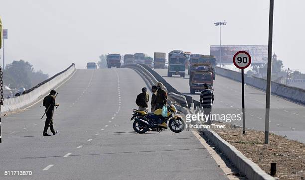 Police jawans stopping vehicles from going to Ladsoli after Jat agitation turned violent on February 22 2016 in Panipat India Jats are agitating for...